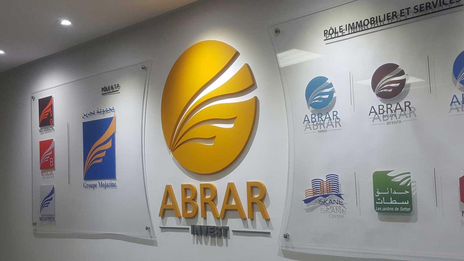 fabrication-logo-3D-mural-massinart-intérieur-siège-entreprise-décoration-bureau-3D-en-MDF-logo-intérieur-en-PVC-logo-3D-découpé-logo-forex-maroc-lettrage-3D-agencement